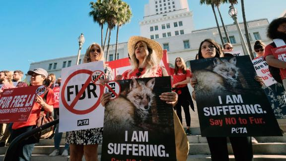 Margo Paine, center, joins protesters with People for the Ethical Treatment of Animals (PETA) in Los Angeles on September 18, 2018.