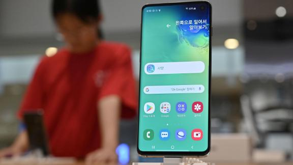 A visitor looks at a Samsung Galaxy S10 smartphone at its showroom in Seoul on August 2, 2019.