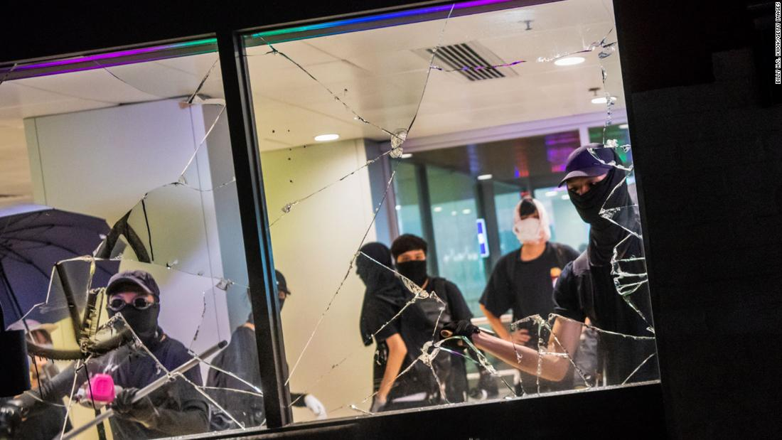 Protesters vandalize a shopping mall restaurant on October 13.