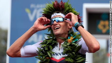 Jan Frodeno celebrates after winning the Ironman World Championships in Kailua Kona, Hawaii.