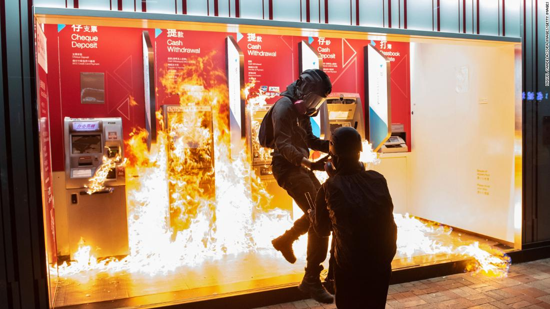 Protesters set fire to a Bank of China branch on Sunday, October 13. It was the 19th consecutive weekend of anti-government protests in Hong Kong.