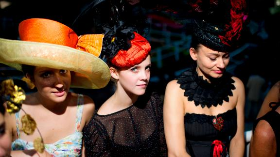 Womens wearing fashionable hats attend the 90th edition of the Qatar Prix de l'Arc de Triomphe at the Longchamp racecourse, outside Paris on October 2, 2011. AFP PHOTO FRED DUFOUR        (Photo credit should read FRED DUFOUR/AFP/Getty Images)