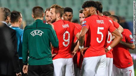 England players speak with the referees during the interruption of the clash against Bulgaria.