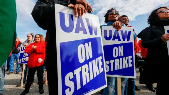 FLINT, MI - OCTOBER 13: United Auto Workers union members and their families rally near the General Motors Flint Assembly plant on Solidarity Sunday on October 13, 2019 in Flint, Michigan. The UAW strike of GM enters its fifth week at midnight tonight, the union