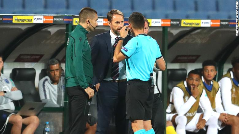 Gareth Southgate speaks with referee Vasil Levski during the UEFA Euro 2020 qualifier.