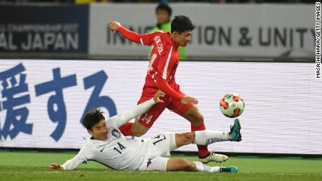 Kang Kuk Chol of North Korea is tackled by Go Yohan of South Korea during a 2017 clash.