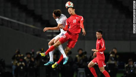 An Byong Jun of North Korea and Kim Shinwook of South Korea compete for the ball during the EAFF E-1 Men's Football Championship between North Korea and South Korea at Ajinomoto Stadium on December 12, 2017 in Chofu, Tokyo, Japan.