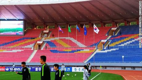 Players warm up before the match begins on October 15, 2019, at the Kim Il Sung Stadium in Pyongyang, North Korea.