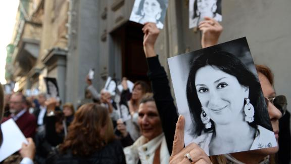People outside a church in Valletta, Malta, after a mass in memory of Caruana Galizia.