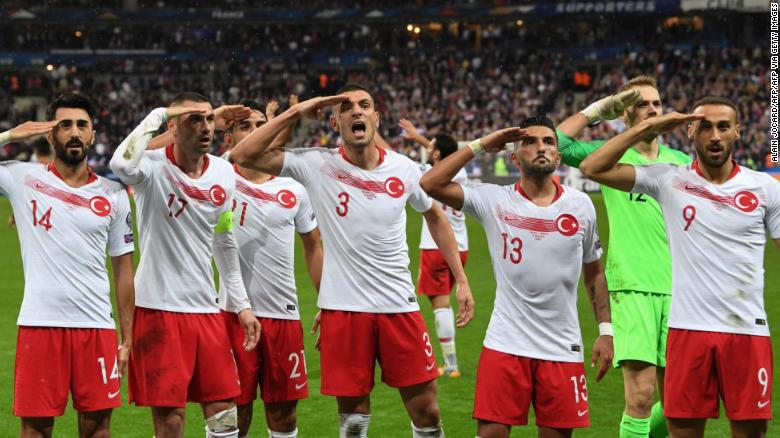 Turkish players salute during the Euro 2020 qualifier against France.