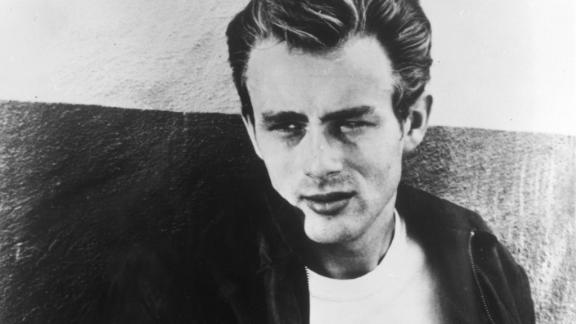 1955:  Portrait of American actor James Dean (1931-1955) leaning against a wall on the set of director Nicholas Ray's film, 'Rebel Without a Cause.'  (Photo by Hulton Archive/Getty Images)