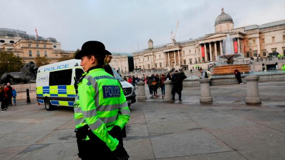 Police officers are seen deployed around Trafalgar Square in London, on October 15, 2019, after the  Extinction Rebellion protest camp was cleared overnight from the Square and as demonstrations by the climate change action group enter a ninth day. - Activists from the environmental pressure group Extinction Rebellion defiantly vowed to continue their planned two-week campaign of demonstrations in central London on October 15, despite a police ban. (Photo by ISABEL INFANTES / AFP) (Photo by ISABEL INFANTES/AFP via Getty Images)