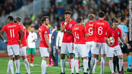 England's players wait on the pitch during a temporary interruption of the Euro 2020 Group A football qualification match between Bulgaria and England due to incidents with fans, at the Vasil Levski National Stadium in Sofia on October 14, 2019. (Photo by Stringer / AFP) (Photo by STRINGER/AFP via Getty Images)