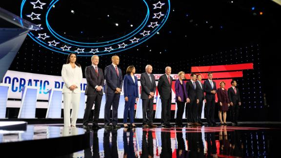 Gabbard, left, takes the stage with other Democratic candidates at a debate in October 2019.