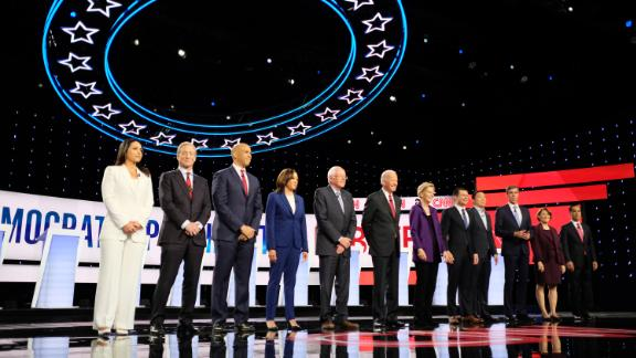 Presidential candidates Tulsi Gabbard, Tom Steyer, Cory Booker, Kamala Harris, Bernie Sanders, Joe Biden, Elizabeth Warren, Pete Buttigieg, Andrew Yang, Beto O'Rourke, Amy Klobuchar and Julián Castro participate in the Democratic debate co-hosted by CNN and The New York Times in Westerville, Ohio, on Tuesday, October 15.