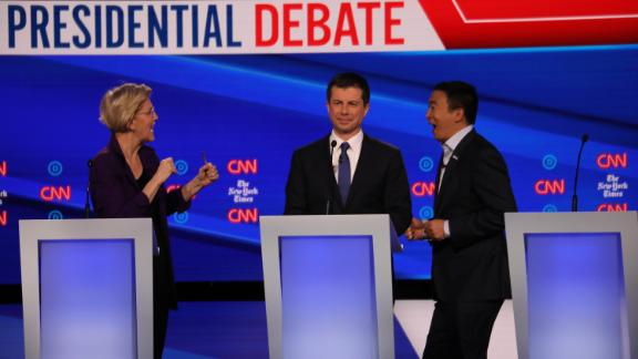 Presidential candidates Elizabeth Warren, Pete Buttigieg and Andrew Yang participate in the Democratic debate co-hosted by CNN and The New York Times in Westerville, Ohio, on Tuesday, October 15.