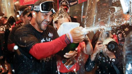 Washington Nationals manager Dave Martinez celebrates after Game 4 of the baseball National League Championship Series.