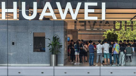 This photo taken on September 28, 2019 shows people visiting a newly-opened Huawei flagship store in Shenzhen in China's southern Guangdong province.