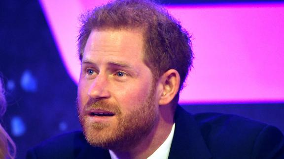 Prince Harry, Duke of Sussex reacts next to television presenter Gaby Roslin as he delivers a speech during the WellChild awards at Royal Lancaster Hotel on October 15, 2019 in London, England.