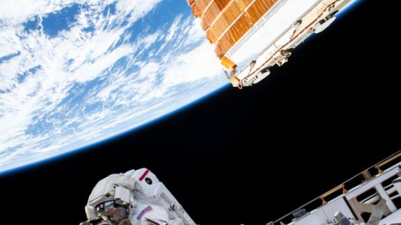 NASA astronaut Andrew Morgan views Earth from 250 miles away during a spacewalk at the International Space Station, an orbiting space laboratory, assembled through a decades-long collaboration of countries.