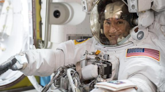 NASA astronaut Christina Koch is suited up in a spacesuit. Koch, who arrived at the International Space Station in March 2019, will set the record for the longest spaceflight by a woman.