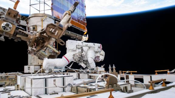 Astronaut Andrew Morgan works while tethered on the International Space Station on October 11, 2019 -- a day after elections officials say he cast his vote.