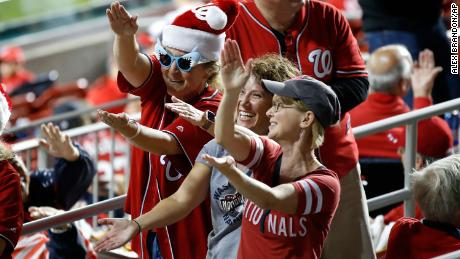 Fans cheer before Game 3 of the baseball National League Championship Series between the St. Louis Cardinals and the Washington Nationals Monday, Oct. 14, 2019, in Washington.