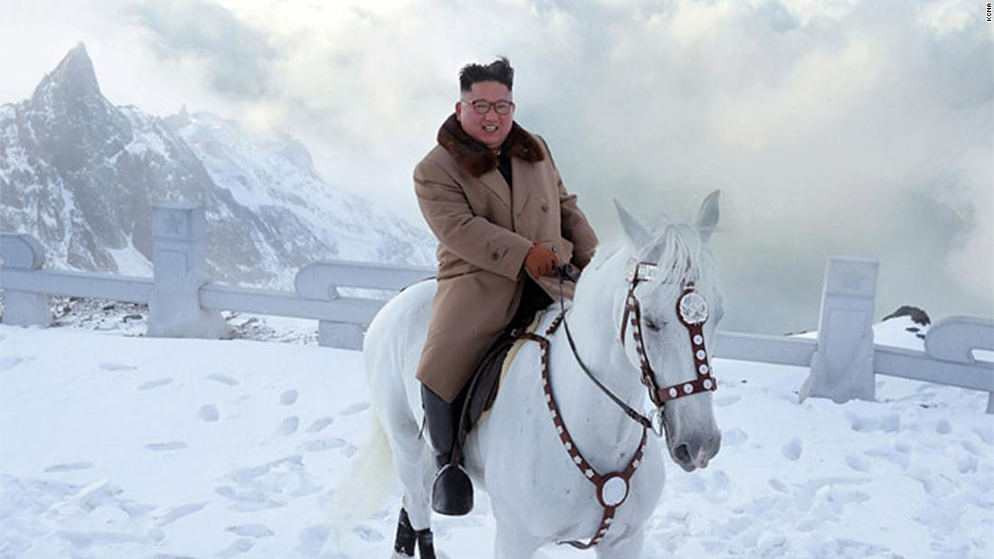 North Korean leader Kim Jong Un rides a white horse on snowy, symbolic mountain