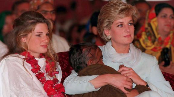 Diana, Princess of Wales, cradles a sick child in her arms while she sits with Jemima Khan during her visit to Imran Khan