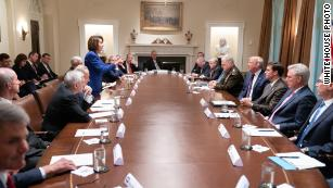 "Trump tweeted this White House photo showing Nancy Pelosi pointing at him saying ""Nervous Nancy's unhinged meltdown!"" as an insult to the Speaker. Pelosi later made the image her cover photo on Twitter."