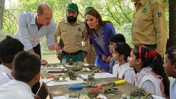 The royal couple talk with local school children in the Margallah Hills on the second day of the royal visit to Pakistan on Tuesday in Islamabad, Pakistan.