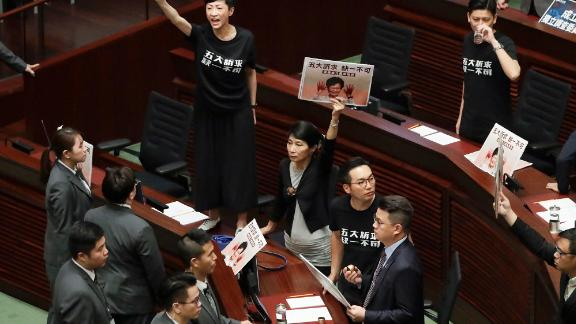 Pro-democracy lawmakers protest as Hong Kong Chief Executive Carrie Lam delivers a speech at the Legislative Council on Wednesday, October 16. Lam
