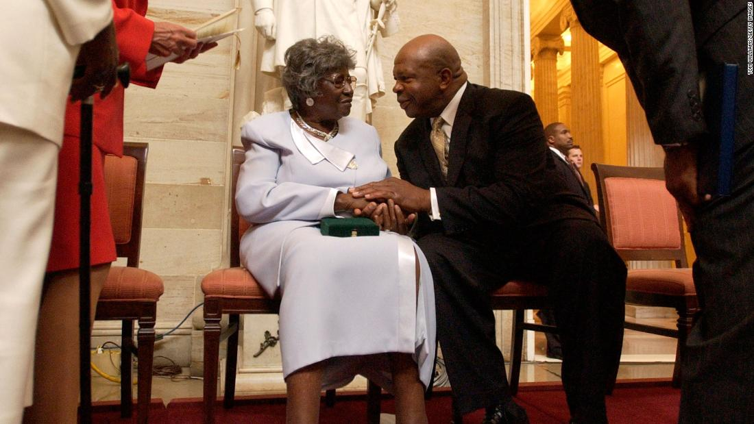 Viola Pearson, the widow of Levi Pearson, talks with Cummings after a ceremony honoring her husband with the Congressional Gold Medal in September 2004. Levi Pearson was among four people honored for their involvement in Briggs v. Elliott, a court case that challenged segregation in South Carolina schools.