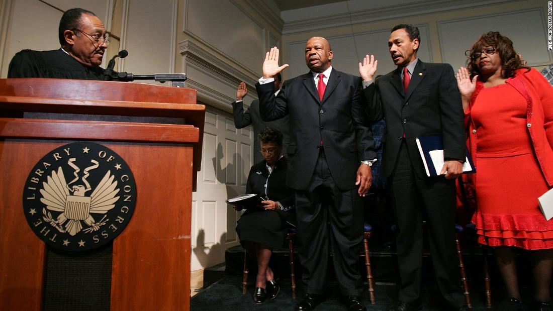 Retired North Carolina Supreme Court Chief Justice Henry Frye swears in Cummings, US Rep. Melvin Watt and US Rep. Corrine Brown as members of the Congressional Black Caucus in January 2005. Watt was replacing Cummings as chairman.