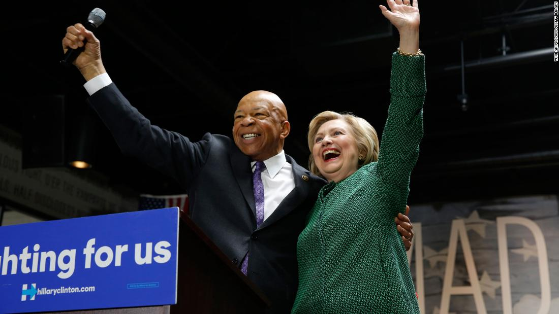 Cummings stands with Democratic presidential candidate Hillary Clinton after endorsing her at an event in Baltimore in April 2016.
