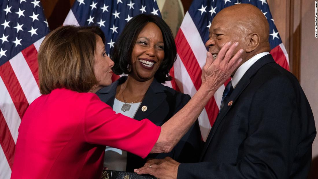 House Speaker Nancy Pelosi congratulates Cummings in January 2019 during a ceremonial swearing-in.