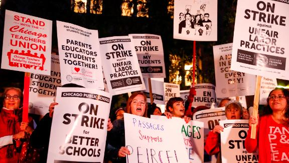 Striking teachers and supporters walk a picket line outside Peirce Elementary School on the first day of strike by the Chicago Teachers Union on October 17 2019 in Chicago, Illinois.