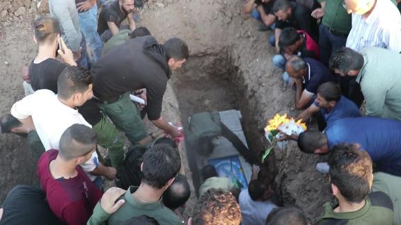 Syrian Kurds bury their dead amid the Turkish offensive