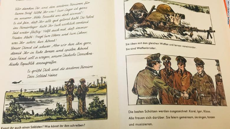 """A first grade textbook features an imaginary letter from 'Soldier Heinz' to a pupil. It reads: """"Our army service is difficult. But we keep on doing it so you can study and play in peace. No enemy should dare to attack our German Democratic Republic."""""""