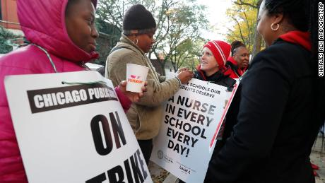 Striking teachers and picketers outside John J.'s school. A Pershing Magnet in the Bronzeville District on Thursday.