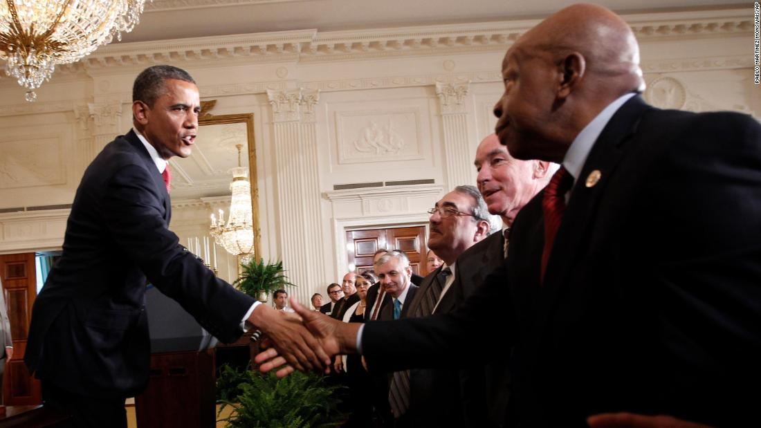President Barack Obama shakes hands with Cummings after signing HR 4348, the Surface Transportation Bill, during a ceremony at the White House in July 2012.