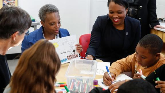 Mayor Lori Lightfoot, second from left, and Chicago Public Schools CEO Janice Jackson, right, check on students at the McCormick YMCA of Metro Chicago on Thursday.