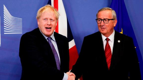 British Prime Minister Boris Johnson (L) shakes hands with President of the European Commission Jean-Claude Juncker on October 17, 2019.