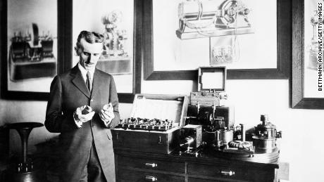Nikola Tesla is pictured in his laboratory. The Serbian-American inventor was involved in numerous discoveries and inventions including the rotating magnetic field, the Tesla Coil, and induction motors.