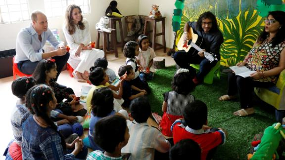 William and Kate were given finger puppets when they joined a musical storytelling session at the Village.