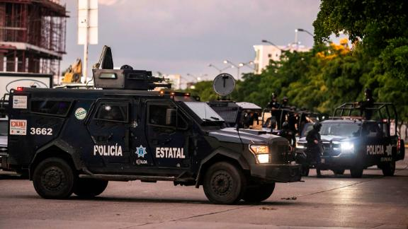 Police patrol a street of Culiacan after gunmen fought an intense battle with security forces.