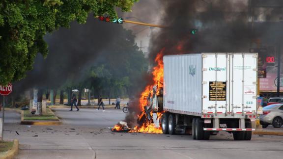 A truck burns in a Culiacan street during Thursday