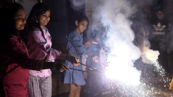 People burst firecrackers for Diwali on November 7, 2018 in New Delhi, India.