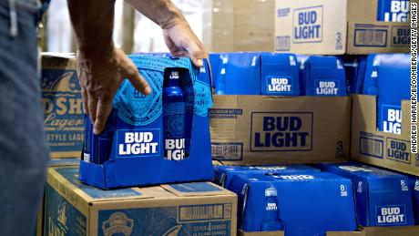 An employee adjusts bottles of Bud Light brand beer at an Anheuser-Busch InBev NV facility during a campaign stop by Senator Tim Kaine, a Democrat from Virginia, not pictured, in Williamsburg, Virginia, U.S., on Wednesday, Aug. 8, 2018. Kaine will face Republican opponent Corey Stewart in the November midterm elections.