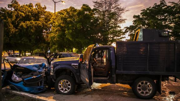 """EDITORS NOTE: Graphic content / View of bullet ridden and crashed vehicles in a street of Culiacan, state of Sinaloa, Mexico, on October 17, 2019, after heavily armed gunmen in four-by-four trucks fought an intense battle with Mexican security forces. - Mexican security forces on Thursday arrested one son of jailed drug kingpin Joaquin """"El Chapo"""" Guzman in an operation that triggered fighting in the western city of Culiacan, Security Minister Alfonso Durazo said. (Photo by RASHIDE FRIAS / AFP) (Photo by RASHIDE FRIAS/AFP via Getty Images)"""